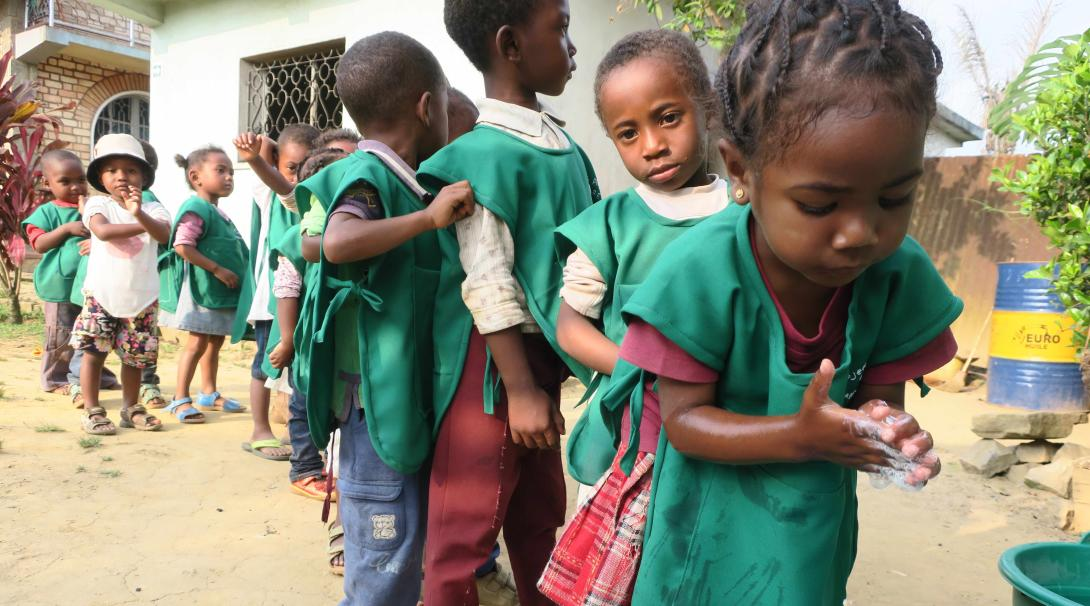 Some children in Madagascar wash their hands as part of the goals of Projects Abroad for all our care projects.